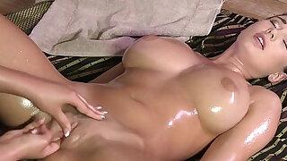Huge round tits brunette lesbo getting erotic massage - duration 7:00
