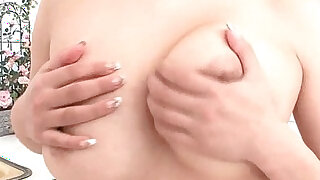 Milk covered HInano fondles her big tits and toys her pussy - duration 5:00